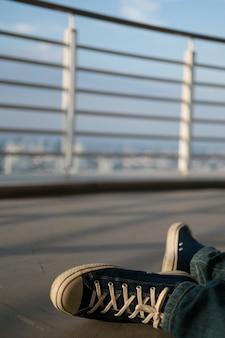 Man were sneaker sit on top of building