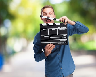 Man with a clapperboard