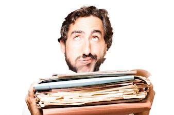 Man with a filing cabinet and a stack of papers