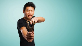 Man with a slingshot