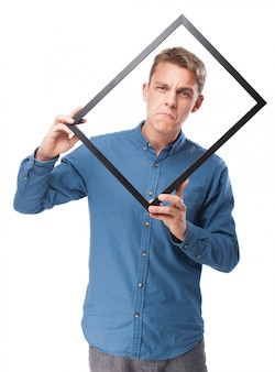 Man with a wooden frame