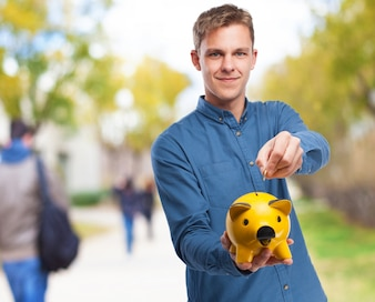 Man with a yellow piggy bank