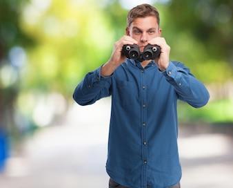 Man with binoculars upside down