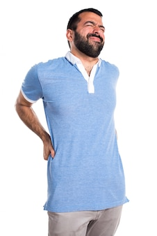 Man with blue shirt with back pain