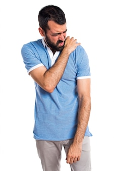 Man with blue shirt with shoulder pain