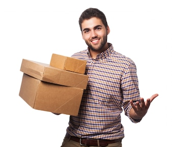 Man with cardboard boxes smiling