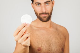 Man with cotton pad