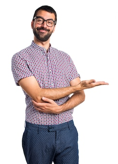 Man with glasses presenting something