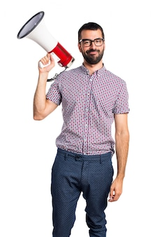 Man with glasses shouting by megaphone
