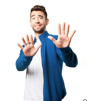 Man with hands in front of body