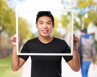 Man with head inside a frame