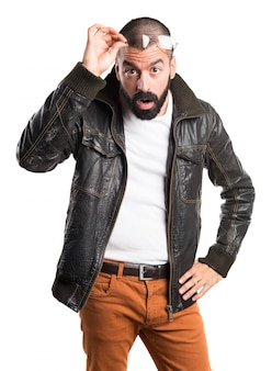 Man with leather jacket showing something