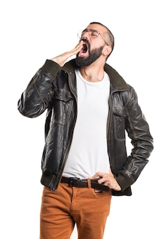 Man with leather jacket yawning