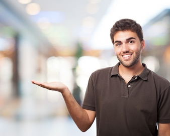 Man with palm up in a shopping enter
