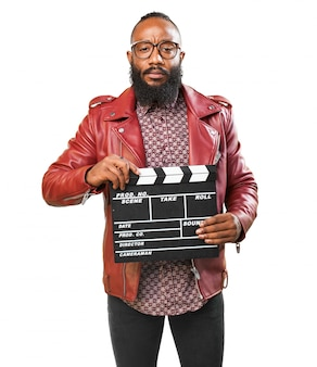 Man with red jacket and a clapperboard