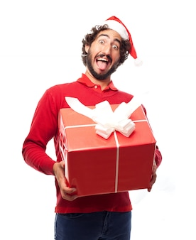 Man with santa's hat with a large gift