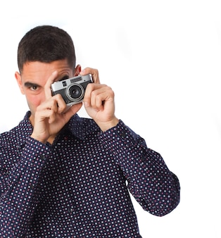 Man with shirt using his classic camera