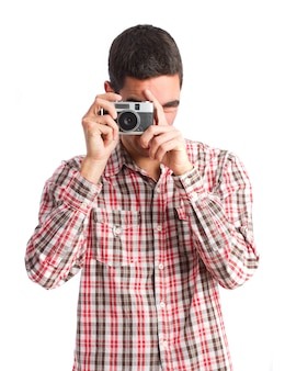 Man with striped shirt taking a photo
