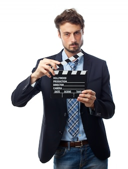 Man with suit and a movie clapboard