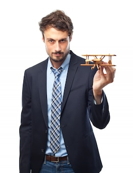 Man with suit and a wooden plane