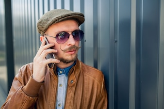 Man with sunglasses talking on the phone