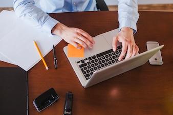 Man working on laptop sitting at table