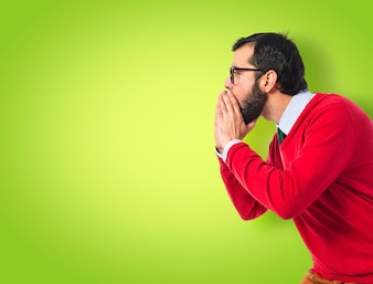Man yelling to his brother on colorful background