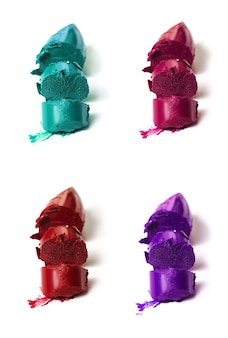 Many beautiful vivid colorful samples of lipstick different colors. Isolated. Collection of lipsticks.