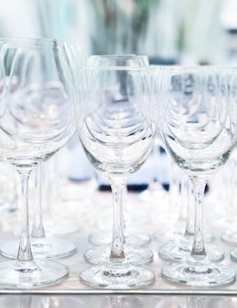 Many empty glasses in a line