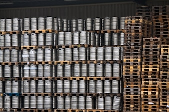 Many metal kegs of beer