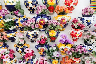 Many vases with flowers inside