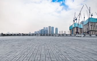 Marble platform in front of the city skyline