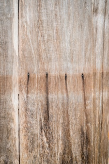 Marks of nail holes on a wooden board