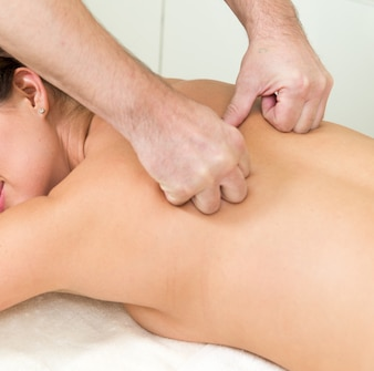 Massage on a woman at spa salon