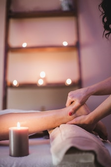 Massage therapist working with woman