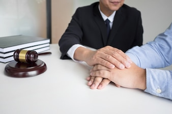 Mature male lawyer or notary with client deciding on marriage divorce in his office.