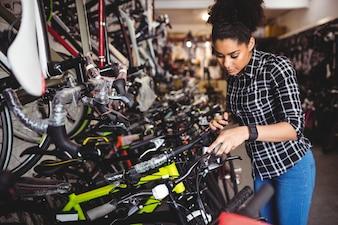 Mechanic examining bicycles