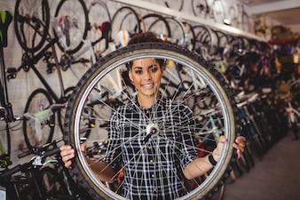 Mechanic holding a bicycle wheel