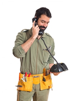 Mechanic talking to vintage phone