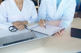 Medical technology network team meeting concept. Doctor hand working smart phone modern digital tablet laptop computer graphics chart interface