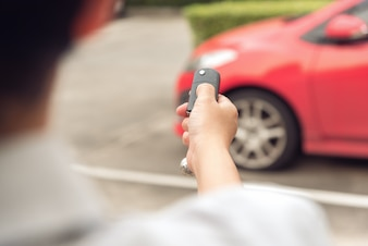 Men's hand open the car with remote control key