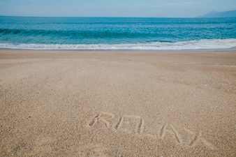 Message on sand saying to relax