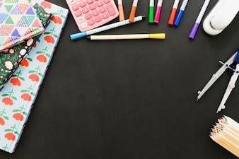 Messy desk full of school materials
