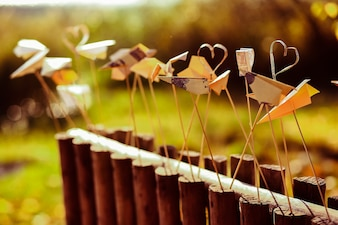 Metal hearts on a wooden fence
