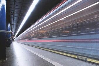 Metro station where metro arrives in motion
