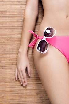 Mid section of a sexy woman in bikini