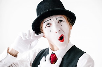Mime cleans his ear