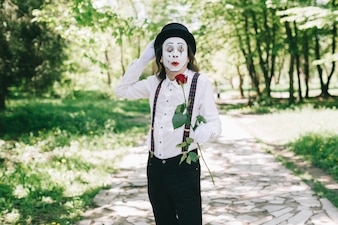 Mime holding his hat