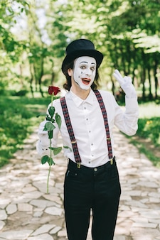 Mime holding red rose