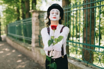 Mime offering a rose